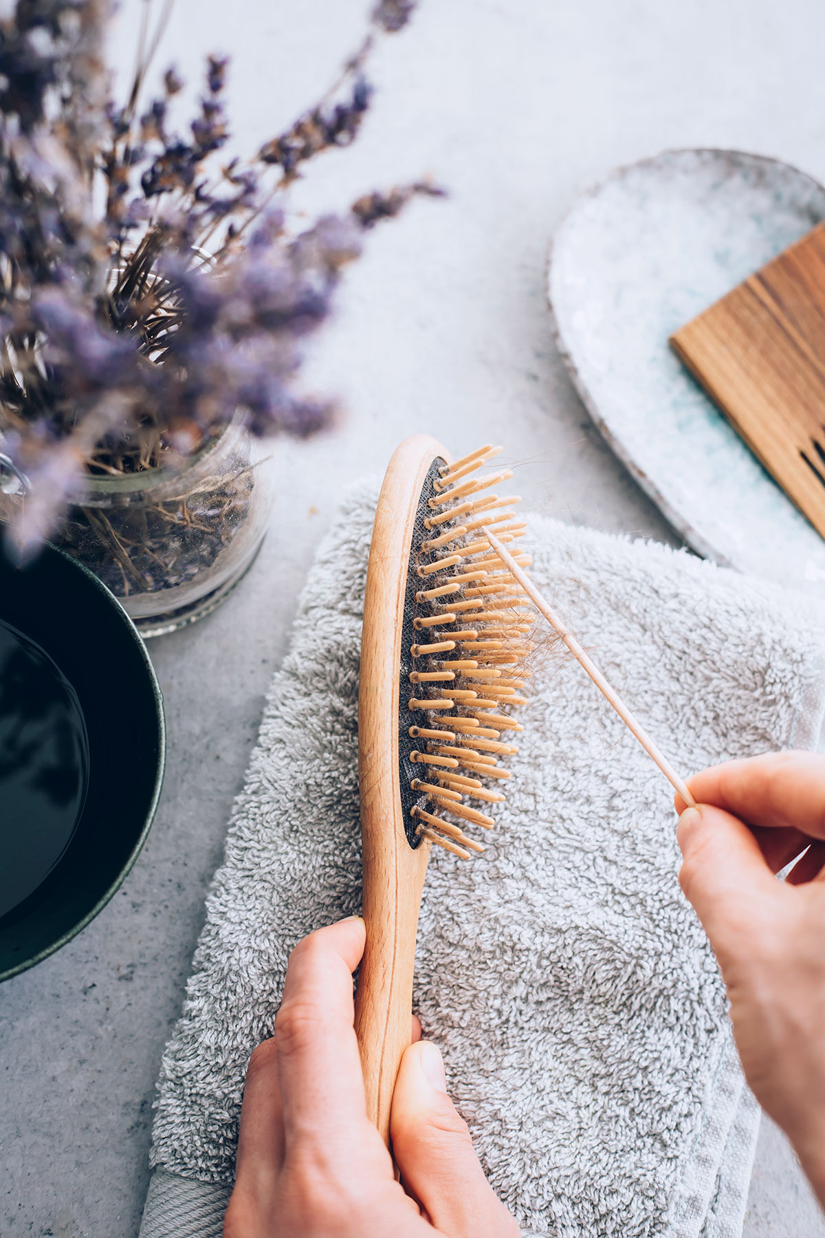 clean hairbrush with toothpick