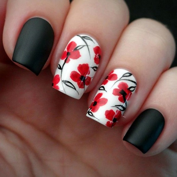 dark floral acrylics with peach red flowers