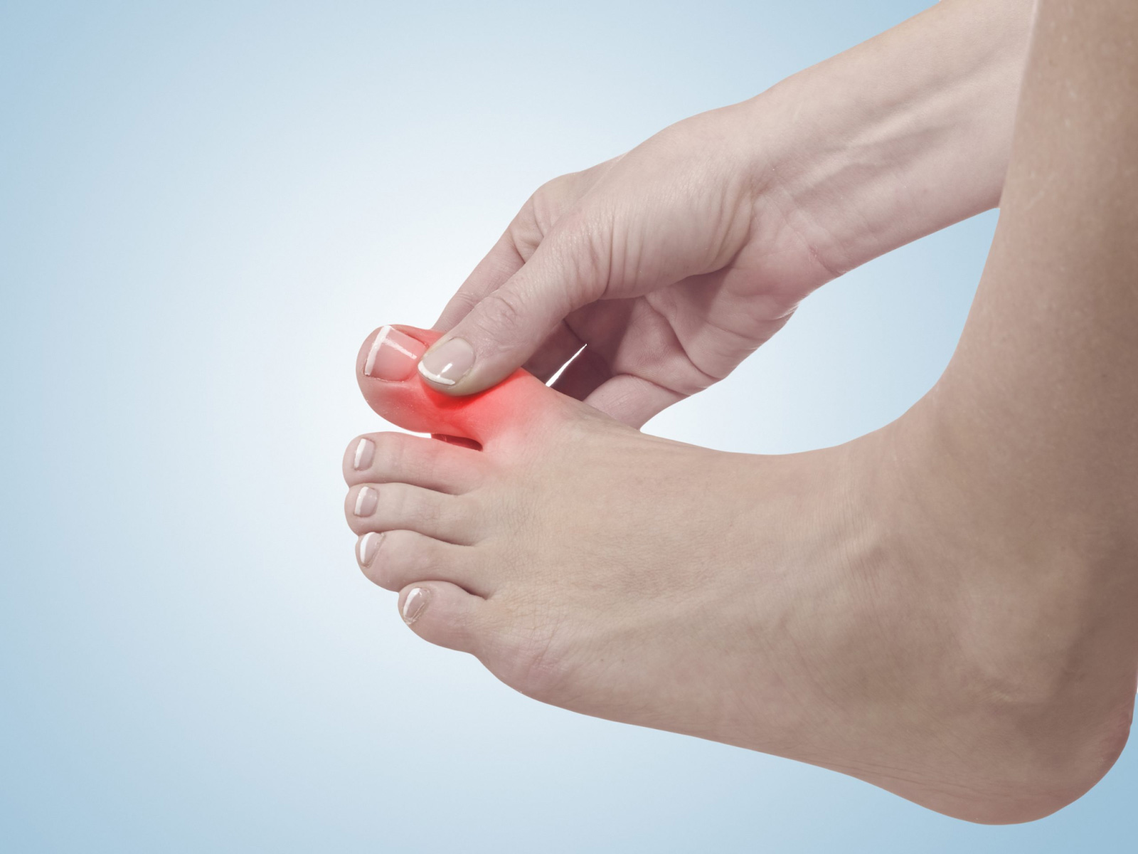 draining the blood from under the toenail
