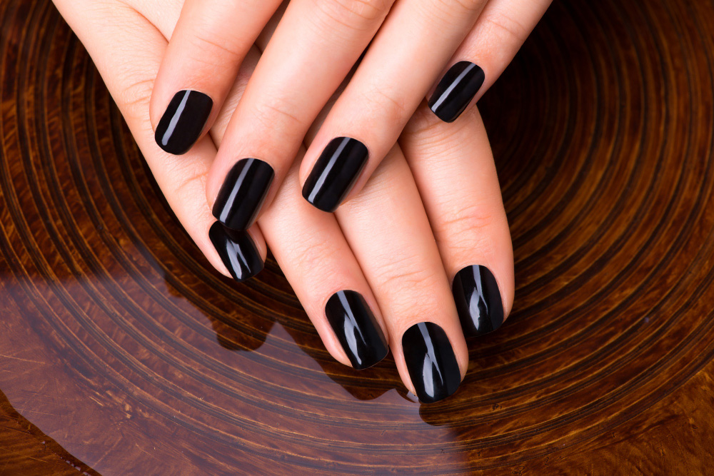 why do guys paint their nails black
