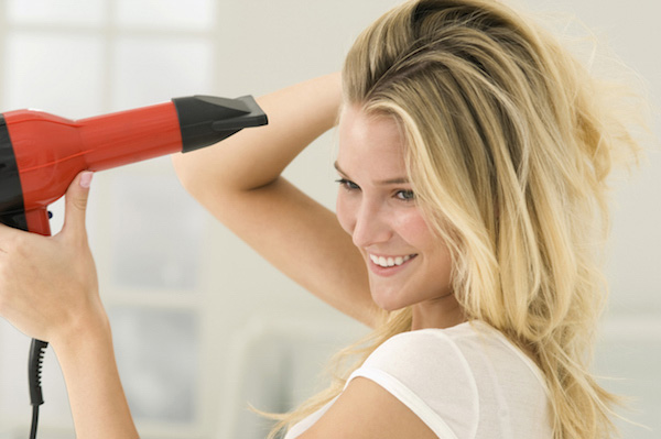dry the hair using a hairdryer